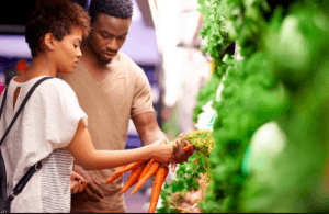 couple saving money on groceries and eating healthy