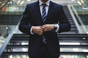 Man in dark blue business suit and tie